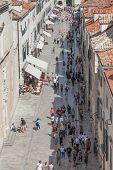 DUBROVNIK, CROATIA - MAY 26, 2014: Crowds walking down Stradun in the old town Dubrovnik, Croatia.