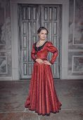Beautiful Woman In Red Long Medieval Dress