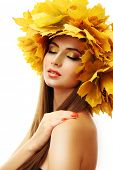 Beautiful young woman with yellow autumn wreath, isolated on white