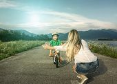 Happiness Mother and son on the bicycle outdoor