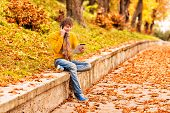 Young Man With Tablet And Talking On The Phone In Outdoor