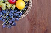 Fresh Fruit In The Basket On The Wooden Table