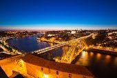 Dom Luiz bridge in Porto Portugal at dusk