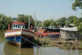 Fishing Boat Lays alongside the Dockage