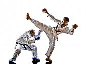 two karate men sensei and teenager student fighters fighting protections isolated on white backgroun