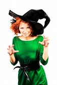 Charming red-haired witch. Halloween. Isolated over white.