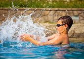 Boy Playing In A Swimming Pool