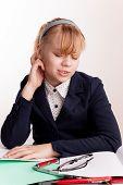 Portrait Of Tired Blond Caucasian Schoolgirl With Headache