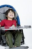 Disabled boy in medical stroller