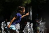 Happy child running in water