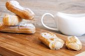 pic of eclairs  - Appetizing eclairs with custard on a table  - JPG