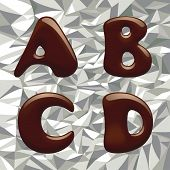 Chocolates alphabet capital letter on the aluminum foil (contain the Clipping Path of all letters)