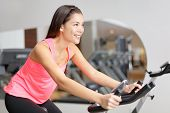 . Fit female model working out training indoor in fitness center.