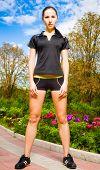 Beautiful young woman in sportswear