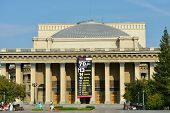 NOVOSIBIRSK, RUSSIA - AUGUST 25, 2014: People in front of the Novosibirsk Opera and Ballet Theater. It's the largest theatrical building in Russia