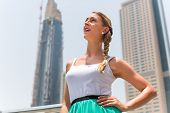 Young woman enjoying view in metropolitan city Dubai