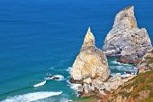 Atlantic coast of Portugal. Two picturesque cliffs of white sandstone, resembling a portion of ice c