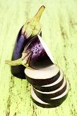 Chopped aubergines on wooden background