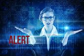 The word alert and businesswoman holding hand out in presentation against blue technology interface with binary code