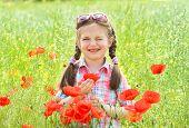 girl in the flower field winks