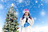 Young women enjoying the snow outdoors.