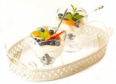 Curd Dessert With Fresh Peaches And Blueberries On White Background