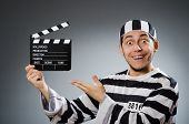 stock photo of inmate  - Inmate with movie clapper board - JPG