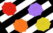 Four Umbrellas On Stripes Background