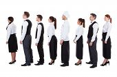 Waiters And Waitresses Standing In Queue