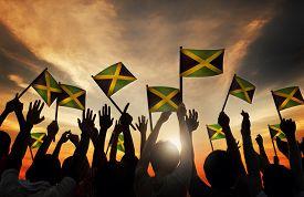 pic of jamaican flag  - Group of People Waving Flag of Jamaica in Back Lit - JPG