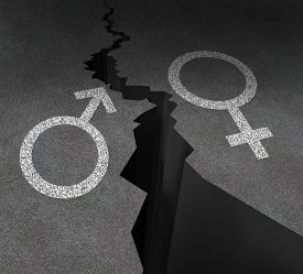 picture of gender  - Gender gap and sex inequality concept as a male and female symbol painted on an asphalt road that is cracked in two as a metaphor for pay or wages inequity or divorce - JPG