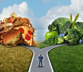 stock photo of fruits  - Diet decision concept and nutrition choices dilemma between healthy good fresh fruit and vegetables or greasy cholesterol rich fast food with a man on a crossroad trying to decide what to eat for the best lifestyle choice - JPG