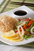 Asian Vegetable Salad With Squid And Rice Noodles Vertical