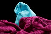 Violet Fabric On A Black Background