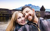 Beautiful Couple taking a selfie photo in Lucerne, Switzerland