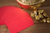 Red Envelopes And Ancient Chinese Golden Ingots On Wooden : With Copyspace