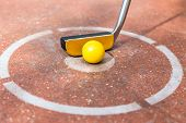 stock photo of miniature golf  - Miniature golf club with ball at round - JPG