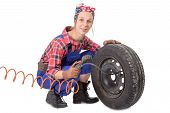 Vintage  Young Woman Inflates A Car Tire
