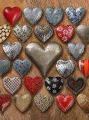 Many Hearts On Wood Background
