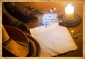 American West Background With Poker Cards And Cowboy Clothes