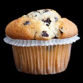 Light chocolate chip muffin in wax liner