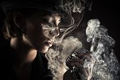 image of smoking woman  - singer woman with retro microphone in smoke - JPG