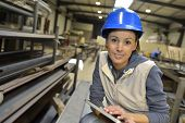picture of mechanical engineering  - Woman engineer in steel plant checking production - JPG