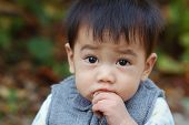 image of snot  - Asian boy is sick with runny nose close up - JPG