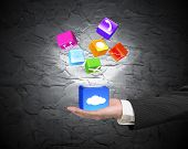 Hand Showing Cloud Box Illuminated App Icons On Concrete Wall