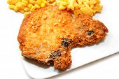 Crispy Baked Breaded Porkchop Served On A Plate