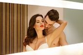 stock photo of mirror  - Passionate sensual couple in mirror foreplay and desire - JPG