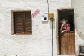 Elderly Woman On The Front Door