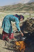 Young woman does housework circa Isfahan, Iran.