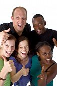 stock photo of ethnic group  - Young fresh multiracial group giving thumbs up sign and are really happy - JPG